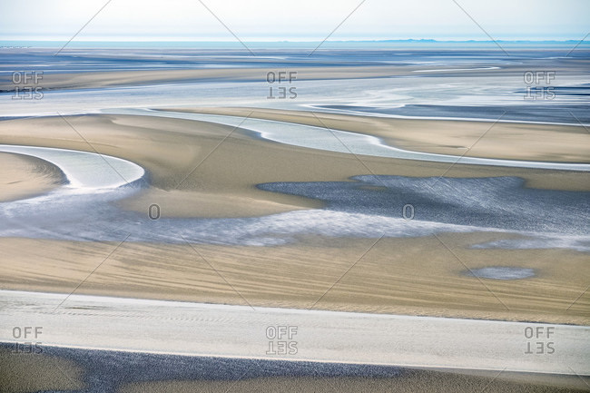 Mudflats surrounding Mont-Saint-Michel at low tide, Normandy, France