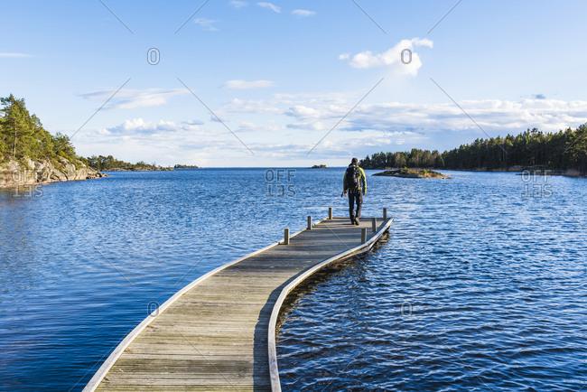 Hiker standing on pier