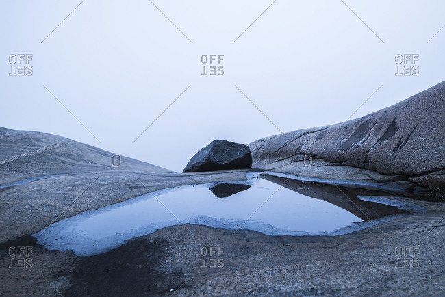 Large puddle on rocks
