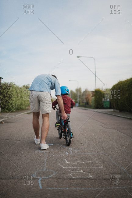 Father teaching son cycling