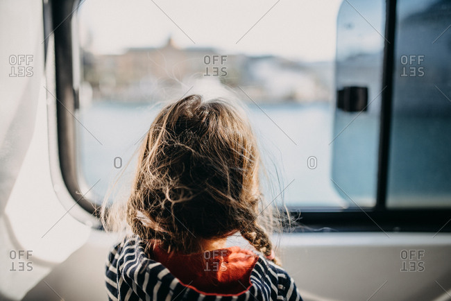 Girl looking out vehicle window