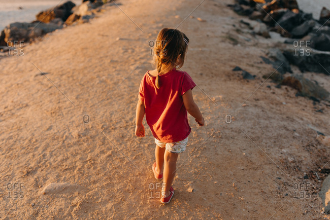 Girl on trail along ocean