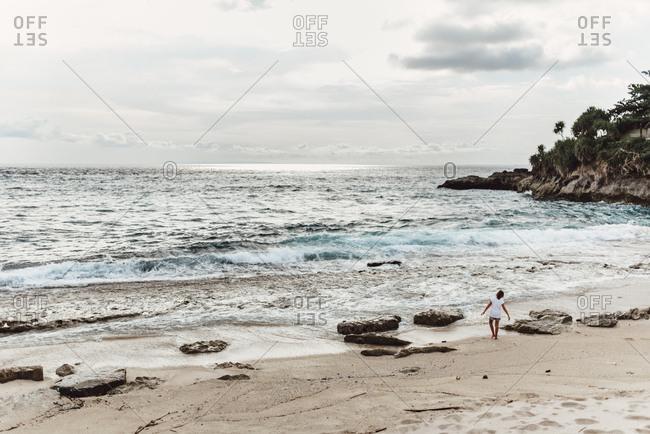 Girl on beach in Bali