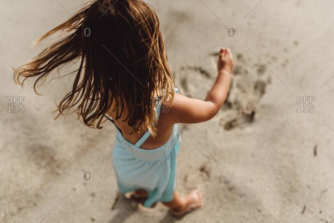 Girl in wind on beach in Bali