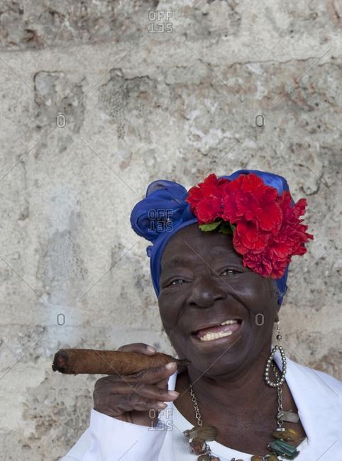 Old lady smoking huge cigar in Cuba