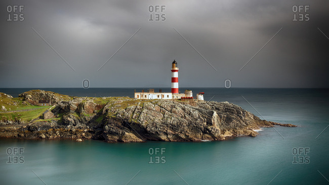 Eilean Glas lighthouse on the island of Scalpay, Western isles. After some heavy rain showers the Sun broke through the clouds and lit up the lighthouse and surrounding landscape, revealing also, the beautiful turquoise water which can be seen so clearly in all weather on the Western isles
