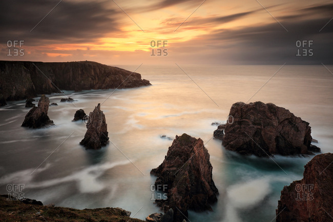 The magnificent sea stacks of Magnasta on the isle of Lewis at sunset