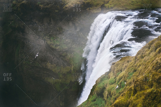 A dramatic waterfall in aerial view