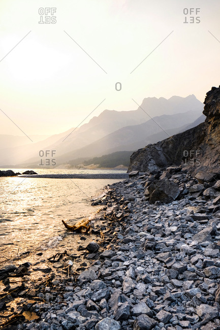 Rocky shoreline along mountains