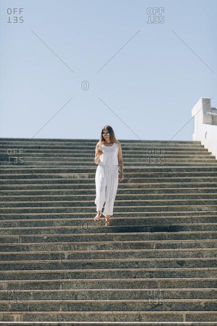 Woman walking down stairs in Seville, Spain