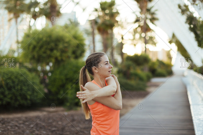 Woman stretching her arms before a workout
