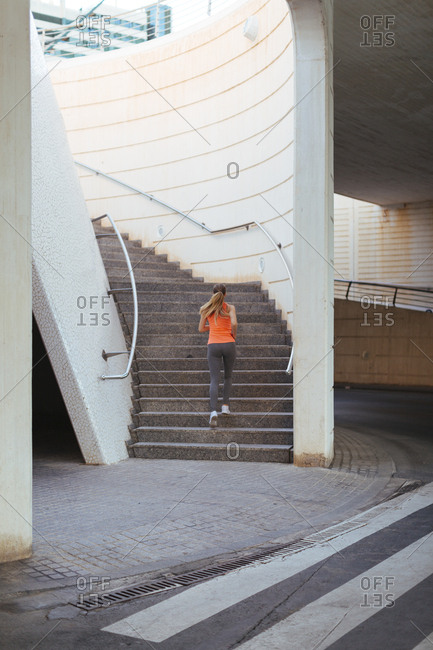 Woman jogging up stairs