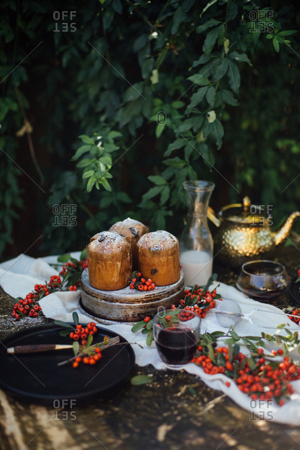 Holiday mini cakes with tea and berries