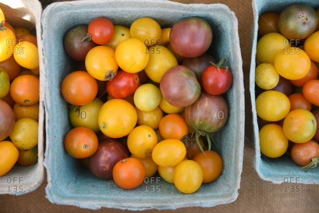 Containers of heirloom tomatoes on display