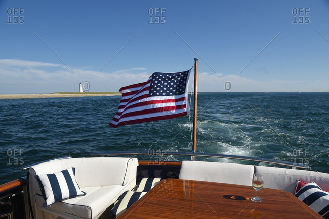 American flag on boat with wine glass on table