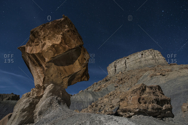 Low angle view of rock formations against star field at Grand Staircase-Escalante National Monument