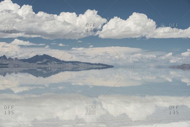 Symmetry view of Bonneville Salt Flats against cloudy sky