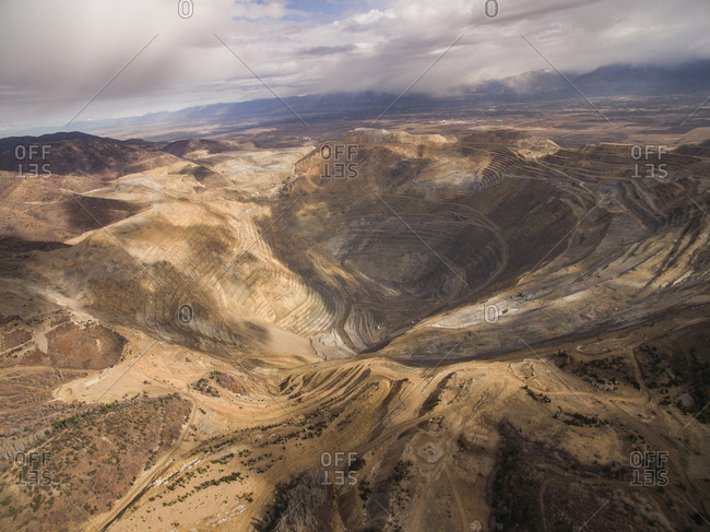 High angle view of Bingham Canyon against cloudy sky