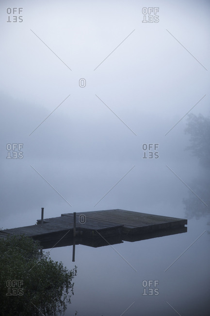 High angle view of wooden pier over lake during foggy weather