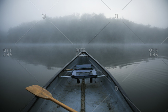 Boat in lake during foggy weather
