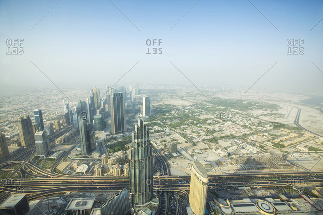 United Arab Emirates, Dubai - September 8, 2016: Aerial view of cityscape against sky during foggy weather from Burj Khalifa