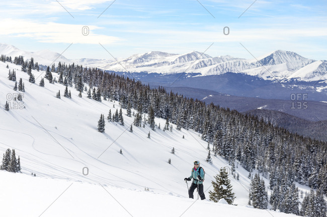 Woman skiing against snowcapped mountains