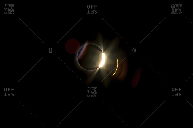 Low angle view of solar eclipse against clear sky