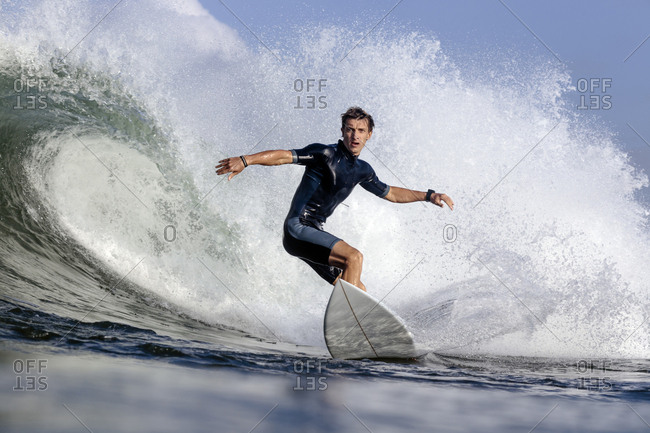 Low angle view of man surfing on sea