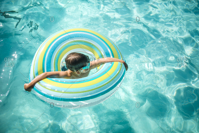 High angle view of boy in inflatable ring