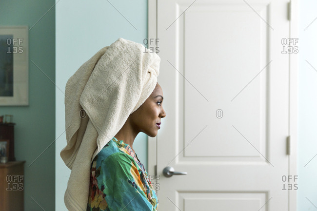 Side view woman looking away while wearing towel on head