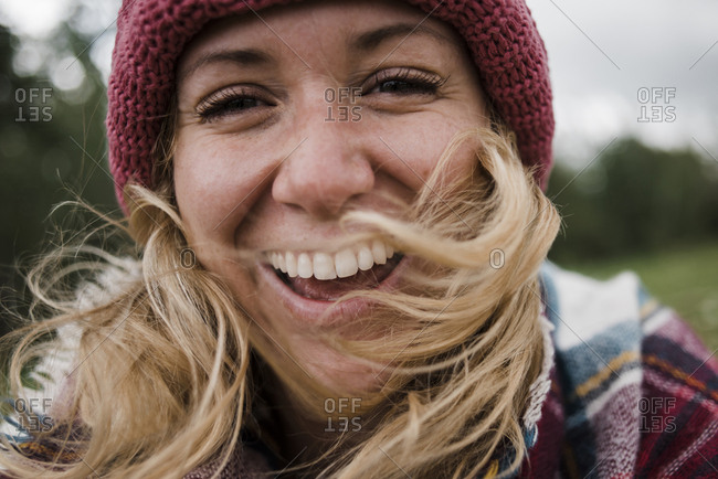 Portrait of cheerful woman wearing knit hat