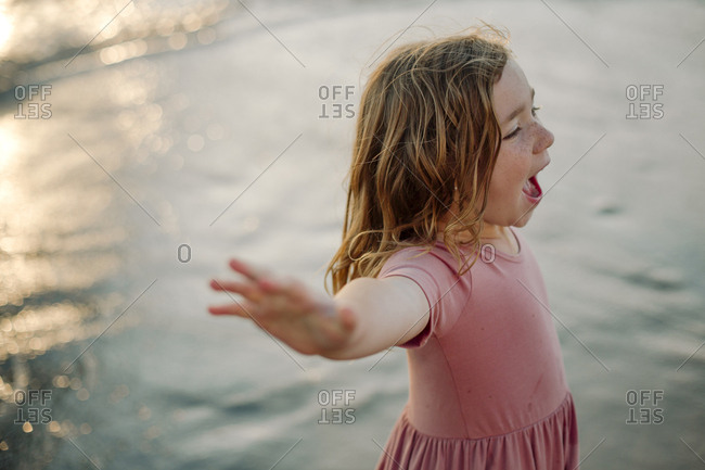 High angle view of girl shouting while looking away at beach