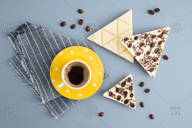 White chocolate with coffee beans and cocoa beans with coffee