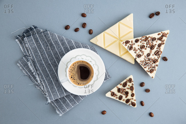 White chocolate with coffee beans and cocoa beans served with coffee