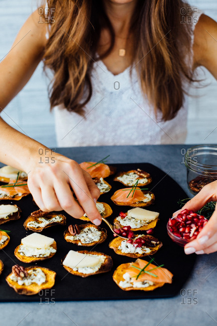 Woman preparing sweet potato crostini