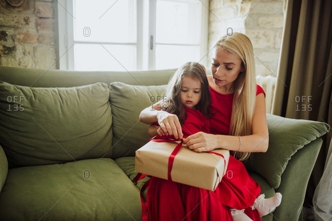 Mother and daughter opening Christmas presents together