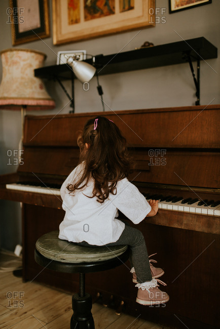Little girl practicing the piano