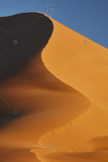 Sand dune shifting in the wind