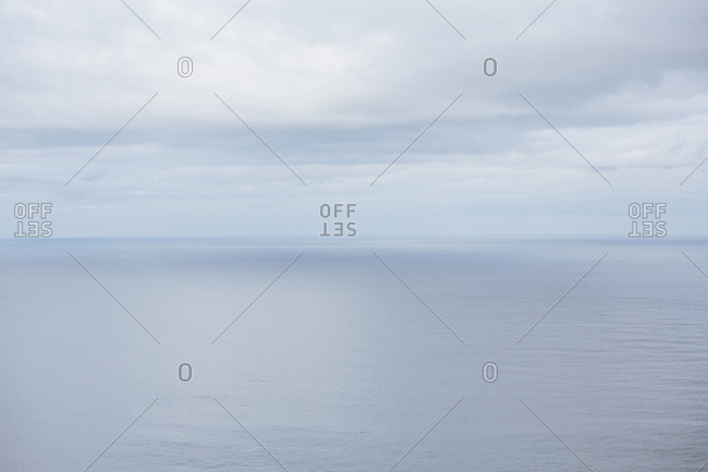 View from the land over the ocean, to the horizon where the sky meets the sea Light clouds
