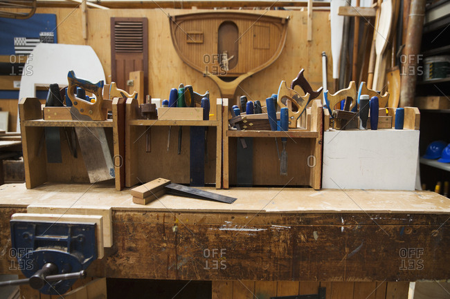 Work bench in a boat-builder's workshop, selection of hand tools for wood working