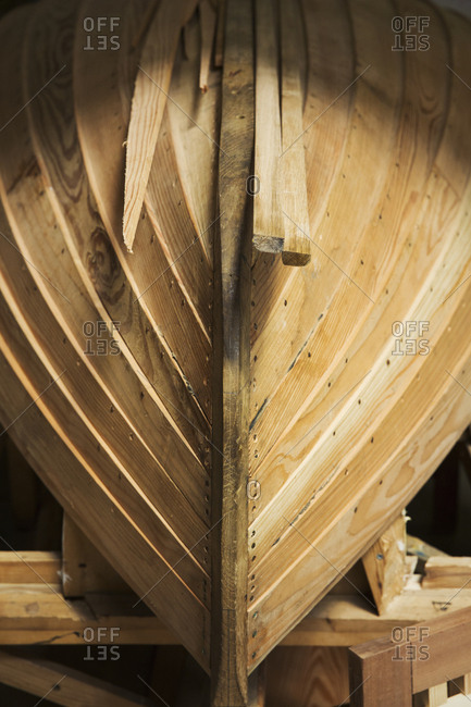 Close up of a wooden boat hull in a boat-builder's workshop