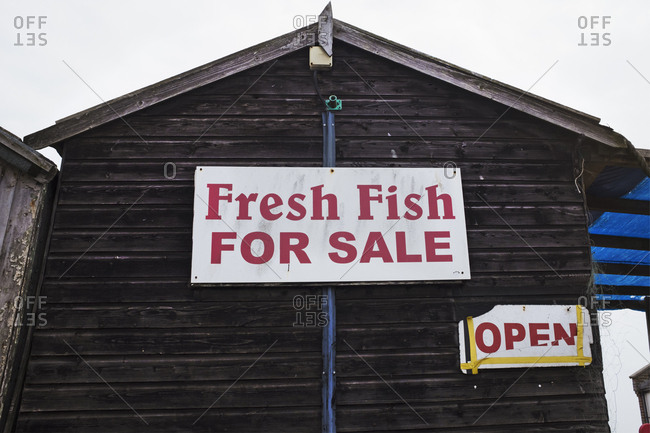 Exterior view of brown wooden fish shop on Suffolk coast