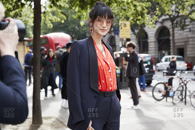 London, England - June 9, 2017: Fashion and trend blogger and designer Betty Banchz having her portrait taken by a photographer in the street during London Fashion Week Men's