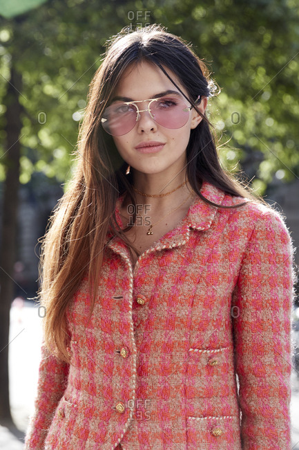 London, England - June 11, 2017: Fashion influencer Doina Ciobanu standing in the street wearing a pink checked suit during London Fashion Week Men's