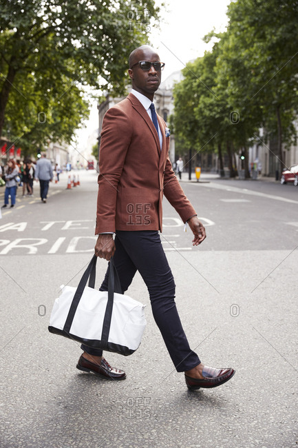 London, England - June 11, 2017: Fashion blogger and writer Anton J Welcome crossing the street during London Fashion Week Men's