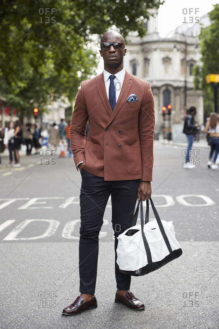 London, England - June 11, 2017: Fashion blogger and writer Anton J Welcome standing in the street during London Fashion Week Men's
