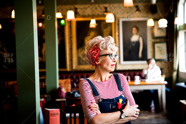 Quirky woman in bar and restaurant, Bournemouth, England