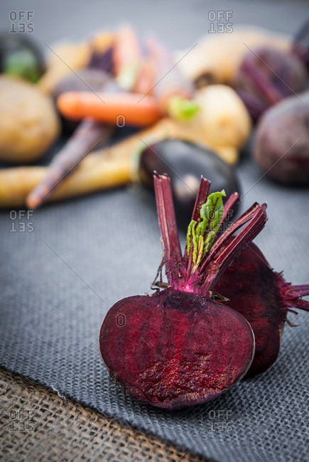 Selection of vegetables, beetroot cut in half in foreground, close-up
