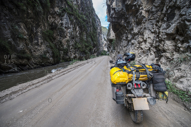 Touring motorbike on a dirt road in Canyon del Pato, Casca, Ancash, Peru, South America