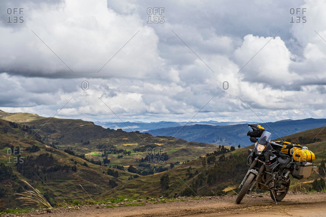 Touring motorbike on a dirt road in the mountains of Peru, Tarma, Junin, Peru, South America